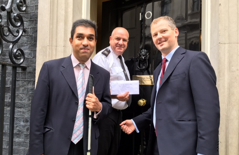 Pardeep Gill and Neil O'Brien MP handing in the petition to downing Street